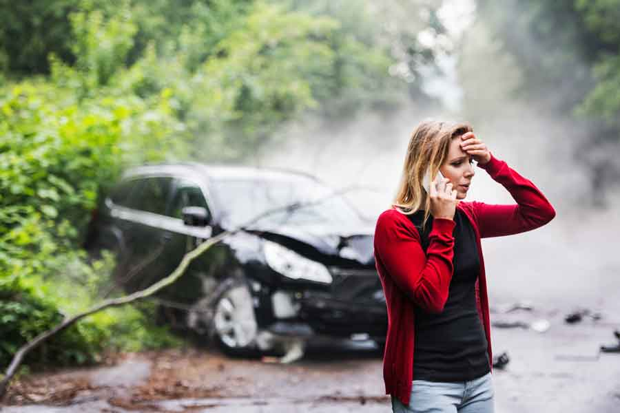woman in red sweater after car wreck